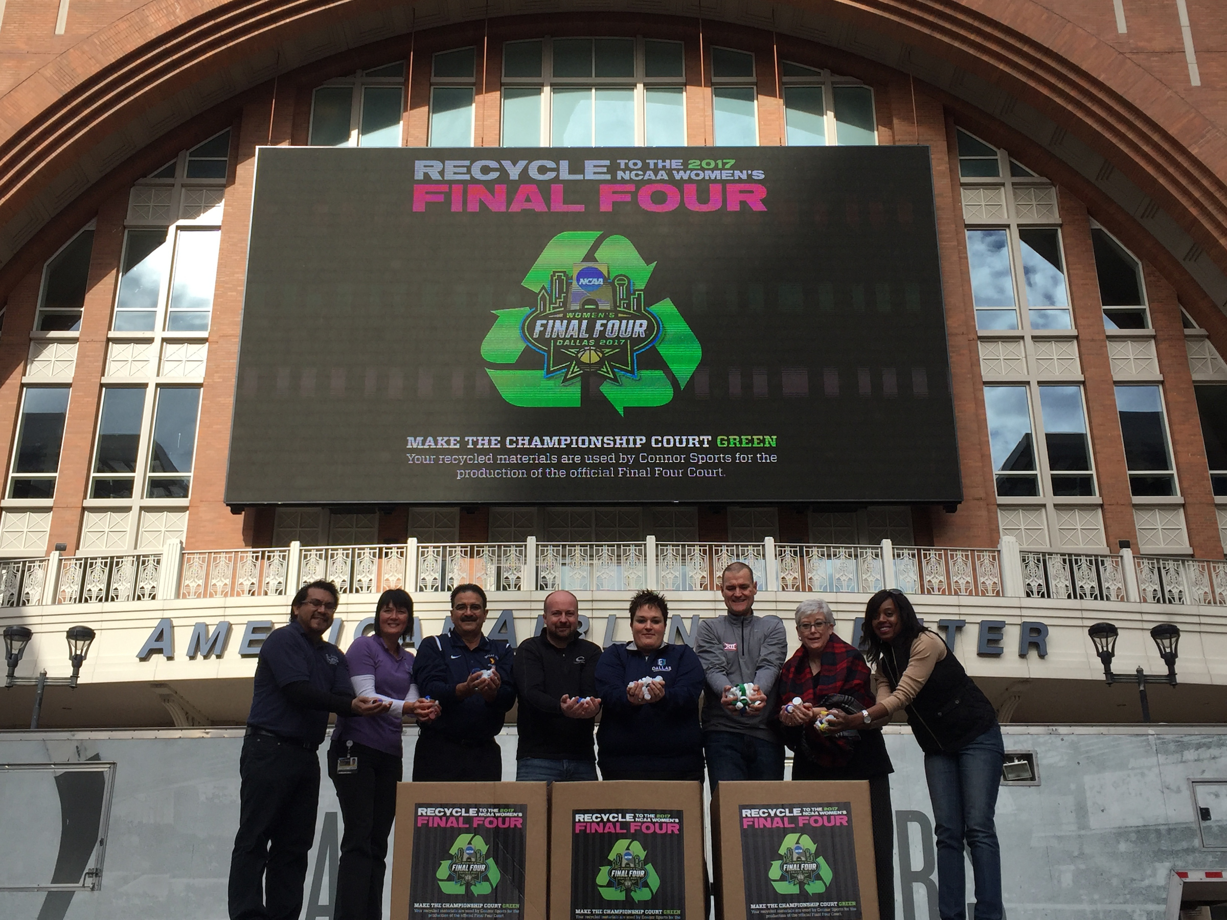 Office of Environmental Quality employees (left) represent the City of Dallas in the Recycle to the Final Four ceremony