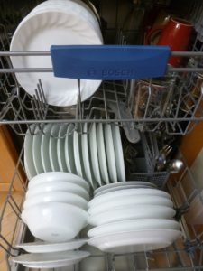 blog photo of clean dishes in a dishwasher